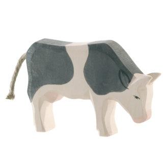 Cow, black & white eating - Ostheimer 11043
