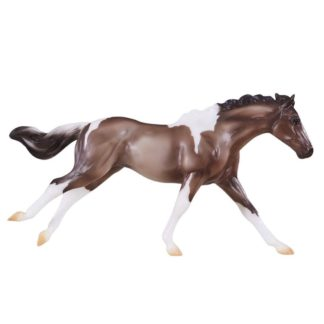 This Grulla Paint Horse is known for her colorful coat pattern and stock horse body type.  This 1:12 scale model is authentically crafted and hand-painted, and is perfect for young collectors.